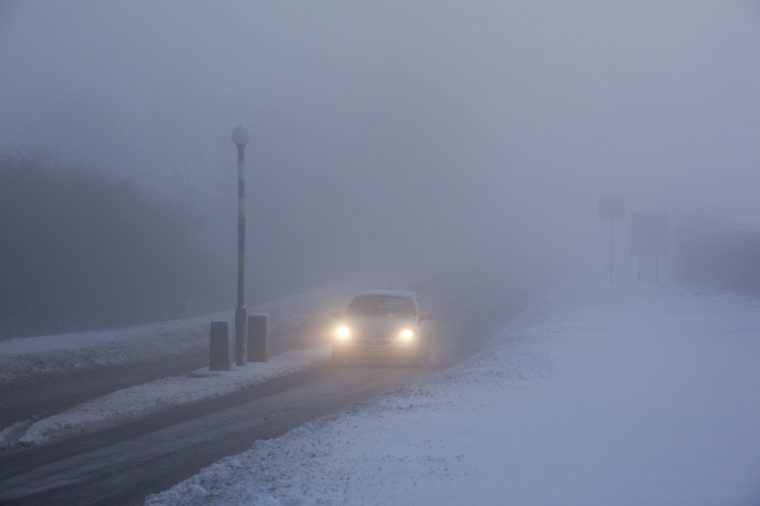 Winter driving in freezing fog on a country road in North Yorkshire in the United Kingdom.