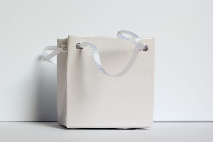 White small gift bag on soft gray background