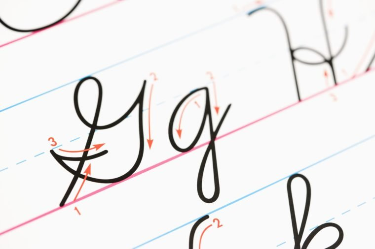 Close up of cursive handwriting practice page.