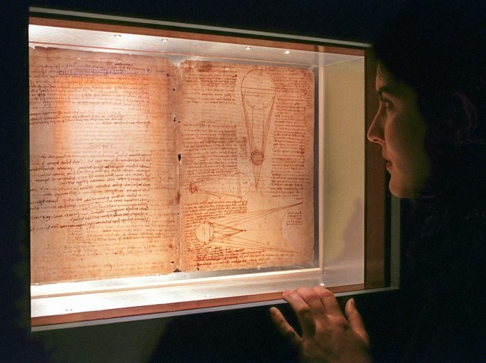 Mandatory Credit: Photo by Richard Drew/AP/Shutterstock (6518428a) GARIPOLI Marisa Garipoli, of New York's American Museum of Natural History, views 2 of 72 pages of Leonardo da Vinci's Codex Leicester on display at the facility, . The manuscript, which is on loan from Bill Gates, covers a wide variety of topics, from astronomy to hydrodynamics and includes Leonardo's observations and theories related to rivers and seas; properties of water; fossils; air; and celestial light LEONARDO'S EXHIBIT, NEW YORK, USA