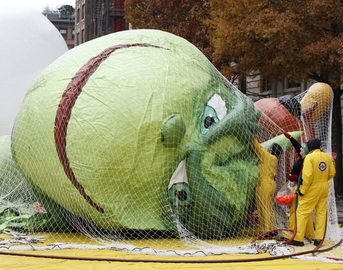 Macy's balloon workers start the inflation of 'Dr. Seuss' The Grinch balloon a day before Macy's 93rd Annual Thanksgiving Day Parade in New York, New York, USA, 27 November 2019.