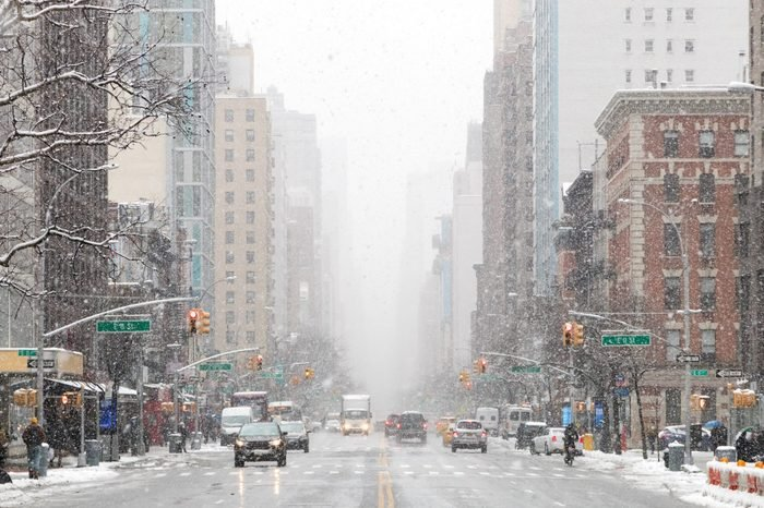 Snowy winter street scene looking down 3rd Avenue in the East Village of Manhattan during a nor'easter snowstorm in New York City