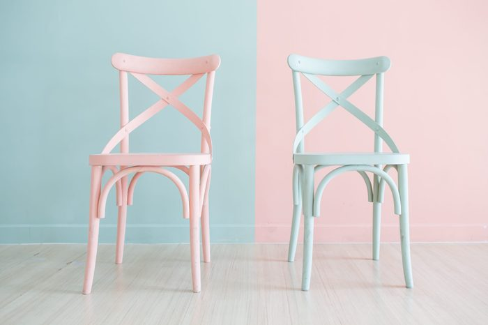 Vintage pastel horizontal wooden chair painted on two tone background