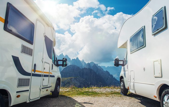 High Mountain Campers Camping. Two Motorhomes and the Scenic Mountain View. Outdoor and RVing Theme.