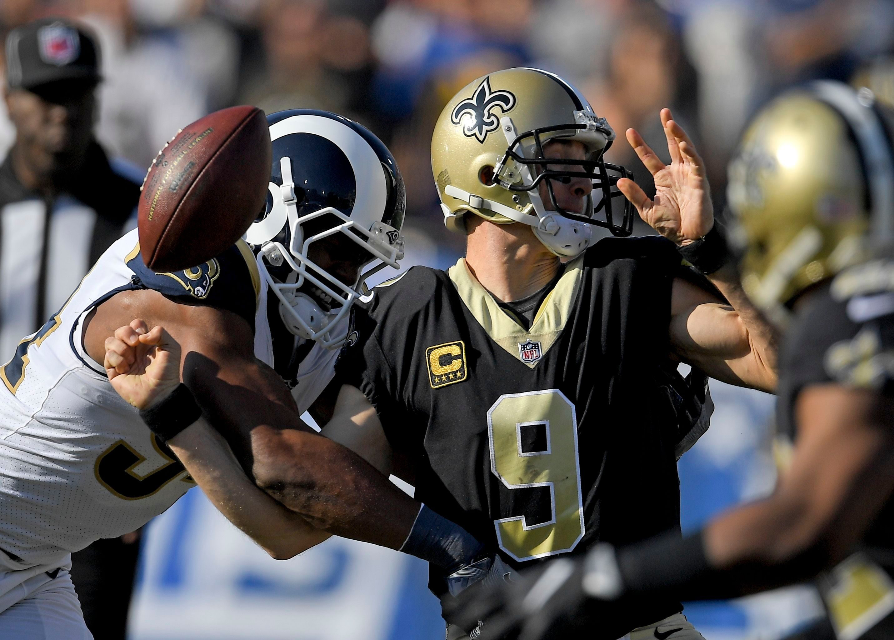 Mandatory Credit: Photo by AP/Shutterstock (9240887g) Los Angeles Rams defensive end Aaron Donald, left, forces a fumble by New Orleans Saints quarterback Drew Brees during the first half of an NFL football game, in Los Angeles. The Saints recovered the ball on the play Saints Rams Football, Los Angeles, USA - 26 Nov 2017