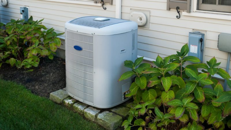 Heating and air conditioning inverter on the side of a house