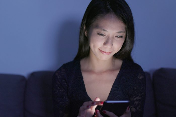 Woman use of mobile phone at home