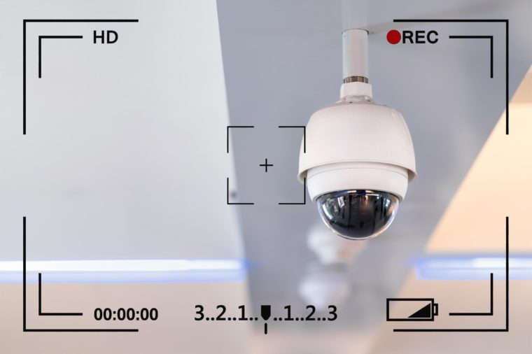 closed circuit camera hanging from ceiling with camera info overlay
