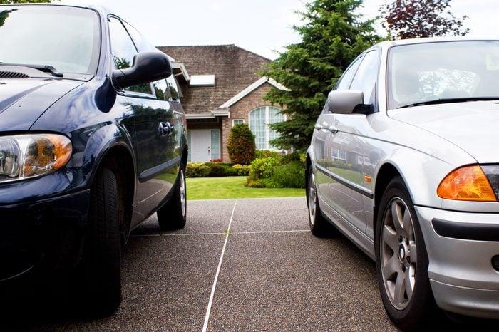 modern suburban family life - 2 cars & a house