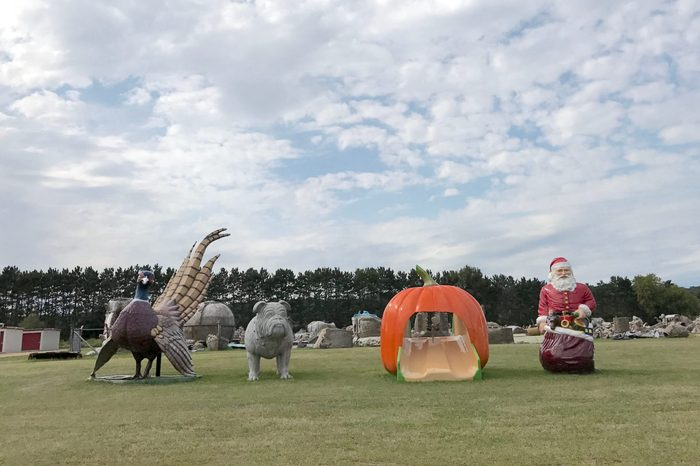 Sparta, Wisconsin / USA / August 25, 2017: 4 fiberglass bird, pig, pumpkin and santa on field owned by FAST (Fiberglass Animals, Shapes, and Trademarks)