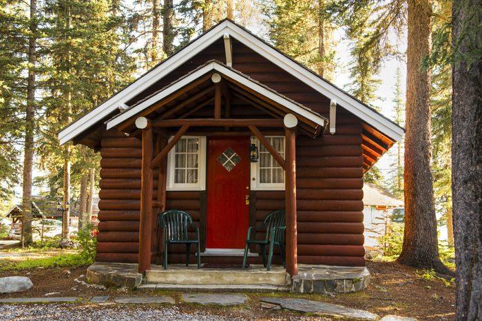 Log cabin in woodland setting