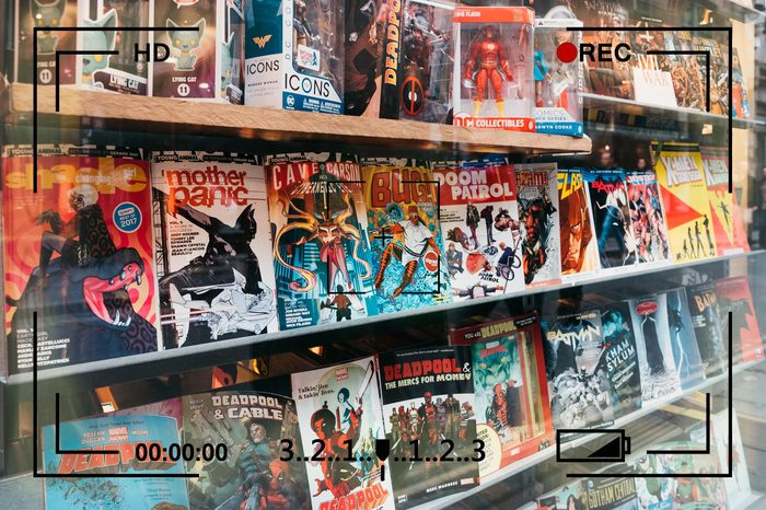 comic books on display with camera info overlay
