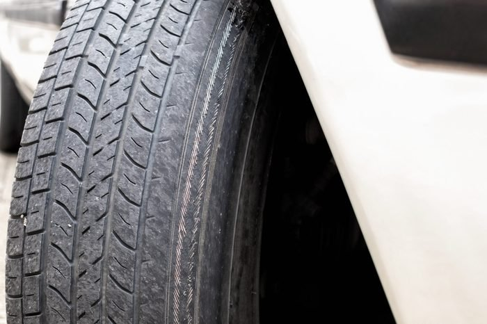 Exposed Metal Wire Cords on badly Worn Tire