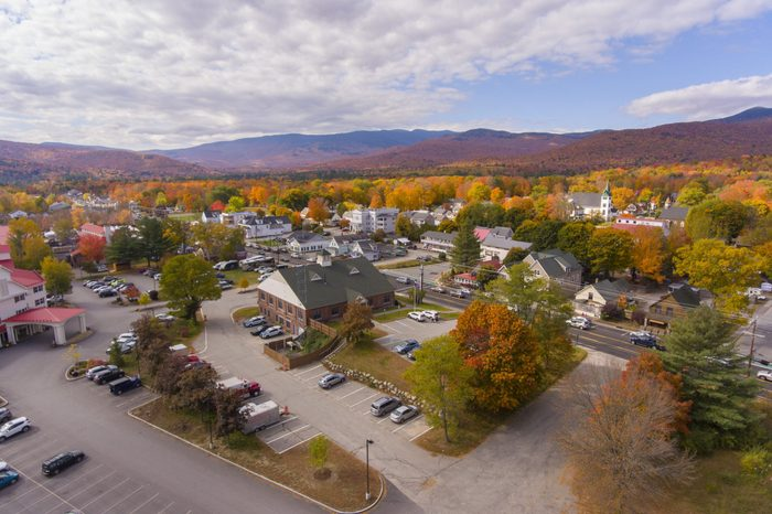Lincoln town hall at Main Street and Kancamagus Highway aerial view with fall foliage, Town of Lincoln, New Hampshire NH, USA.
