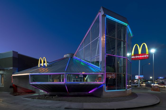 ROSWELL, NEW MEXICO, USA - NOVEMBER 22, 2019: Flying Saucer UFO McDonald's at night on Main Street in downtown Roswell