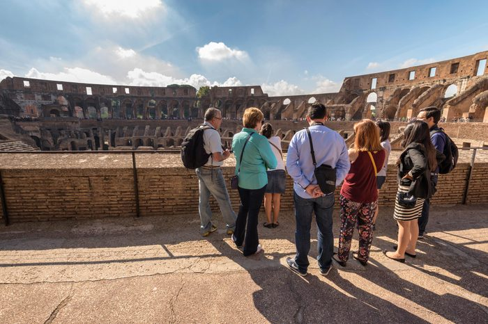 Interior of Colosseum ; tourist group listens guided tour on September 25, 2013 in Rome Italy.
