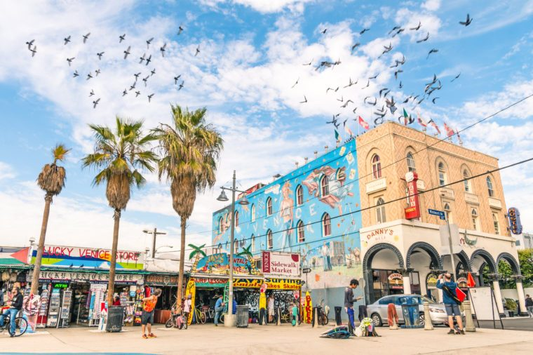 VENICE, UNITED STATES - DECEMBER 18, 2013: big mural in the Ocean Front Walk in Venice Beach, by the artist Rip Cronk who painted some of the most famous murals along the boardwalk and neighborhoods.