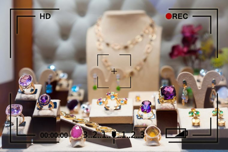 jewelry display with camera recording info overlay