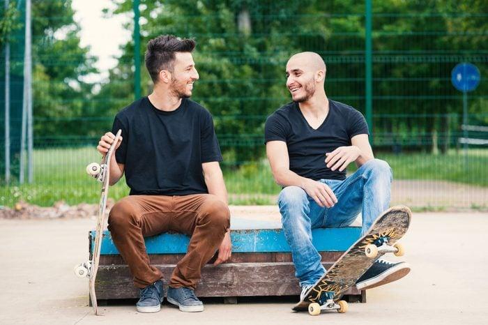 Skateboarder friends portrait having fun at skatepark.