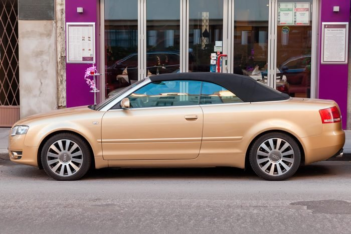 metallic gold Audi A4 Cabriolet stands on the city street