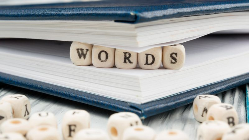 Words word written on wood block in pages of a book