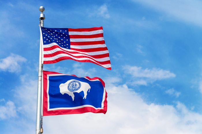 American flag flying a flag pole with the Wyoming state flag