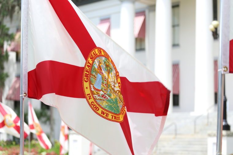 State of Florida flag that has the official seal of the state is planted at the East entrance of Old State Capitol in Tallahassee, Florida.