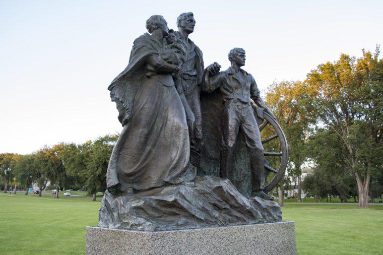 BISMARCK, NORTH DAKOTA - August, 27, 2016: Statue of the Pioneer Family, located on the North Dakota Capital Grounds.