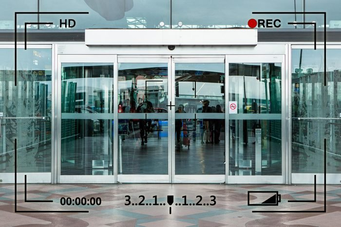 sliding glass doors entrance with camera info overlay