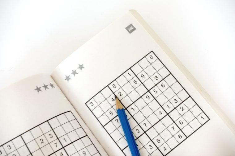 sudoku book isolated on white