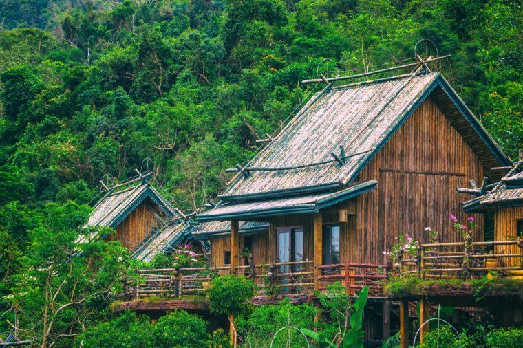 Wooden bamboo house in the jungle. Sanya Li and Miao Village. Hainan, China.