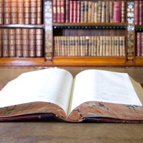Open book in old library.