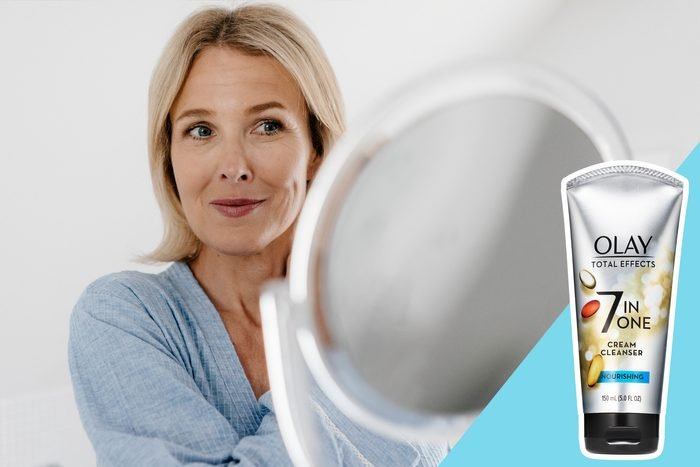 woman looking at her skin in the mirror, with inset of skincare product to buy