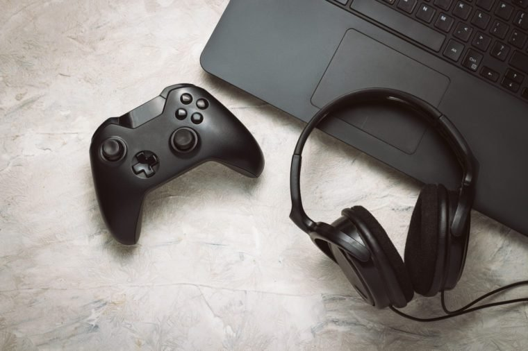 Fun Gamepad Video Console Gaming Game play Gamer player Headset Earphones Keyboard concept.