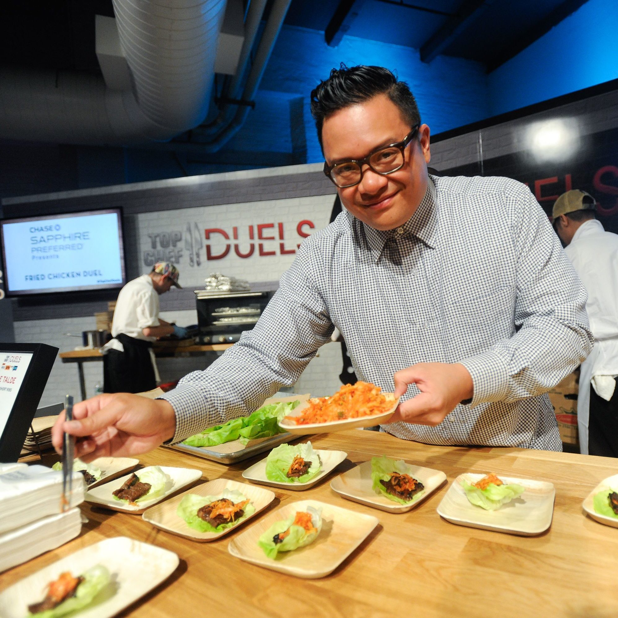 """Mandatory Credit: Photo by Evan Agostini/Invision/AP/Shutterstock (9079439f) Chef Dale Talde prepares a Korean short ribs dish at """"Top Chef Duels"""" Premiere Tasting Event, hosted by Chase Sapphire Preferred and Bravo, at the Altman Building, on in New York """"Top Chef Duels"""" Premiere Tasting Event, New York, USA"""