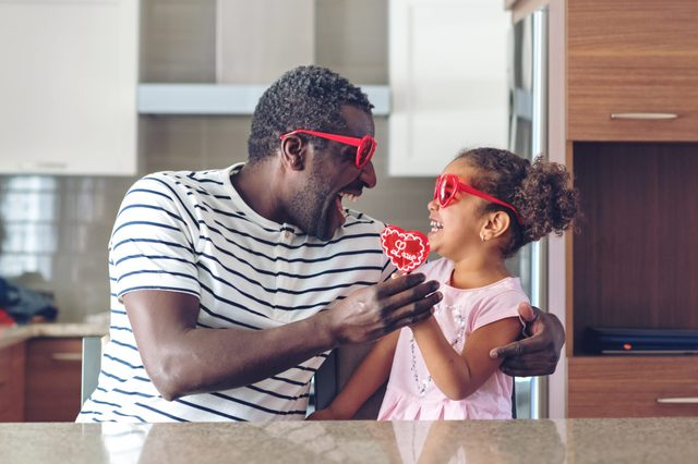 father and daughter in heart glasses. valentines day.