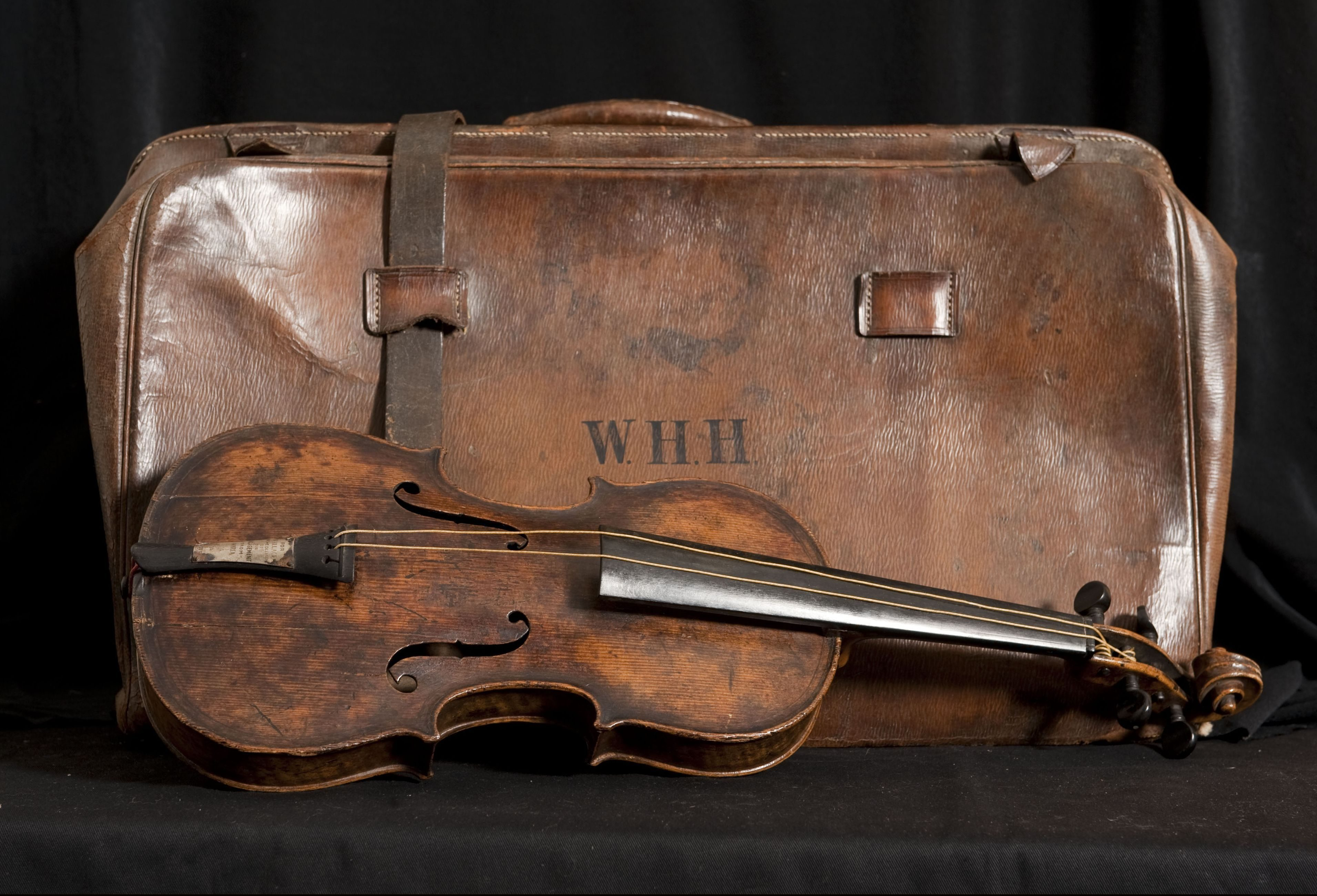Mandatory Credit: Photo by Bournemouth News/Shutterstock (3245064f) The violin and its case Violin played as Titanic sank sells for £900,000, Wiltshire, Britain - 20 Oct 2013 The historic violin that was famously played as the Titanic sank has been sold at auction in Wiltshire for £900,000. The wooden instrument has been proven to be the one used by Wallace Hartley as his band famously played on to help keep the passengers calm during the disaster. Its existence and survival only emerged in 2006 when the son of an amateur violinist who was gifted it by her music teacher in the early 1940s contacted an auctioneers. It had taken seven years for the Devizes auction house, Henry Aldridge & Son, to authenticate the instrument. Several experts were used, including forensic scientists who said the wood still contained salt deposits from the sea water. It is said that the violin survived because it was in a leather case strapped to Mr Harley's body. The new owner of the instrument has remained anonymous but is believed to be British.