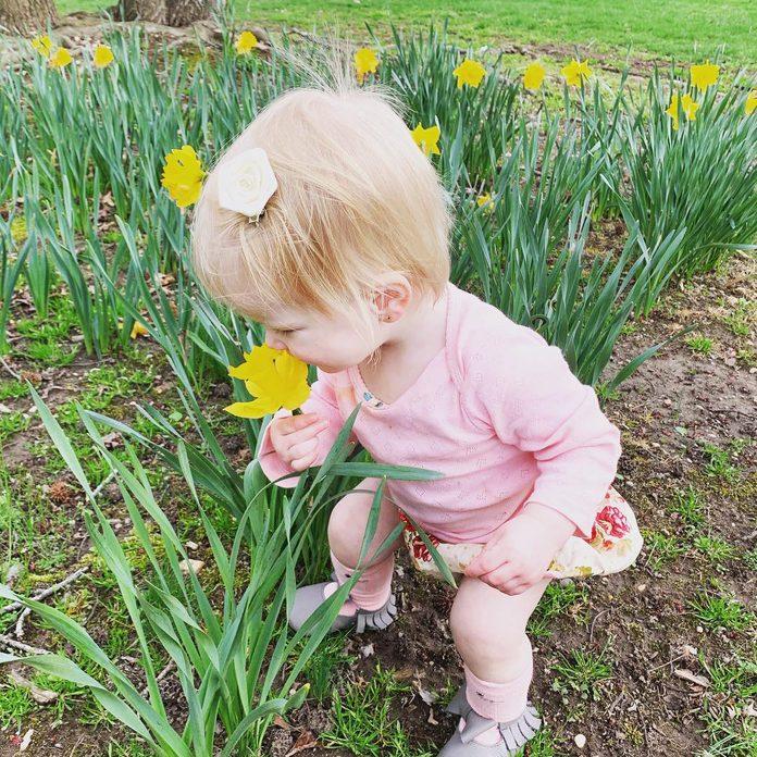 little girl tulips spring