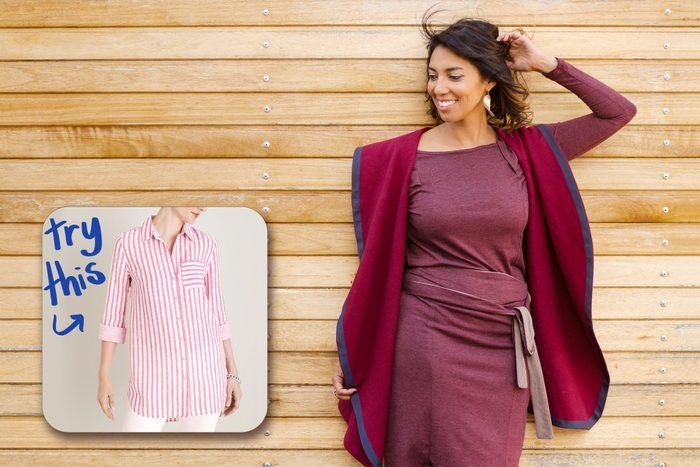 happy woman standing against wall with inset of shirt to buy