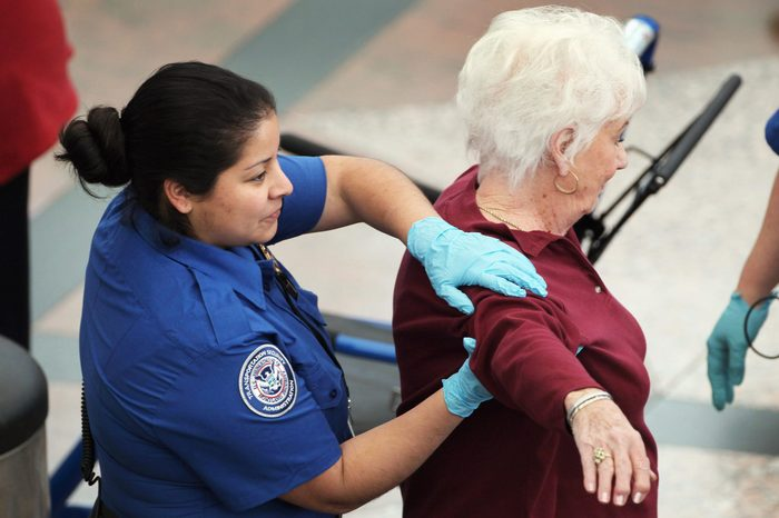 A traveler undergoes an enhanced pat down by a Transportation Security Administration agent at the Denver International Airport on November 22, 2010 in Denver, Colorado.