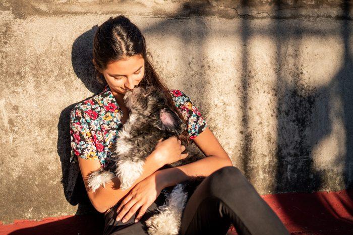 woman dog lap dog