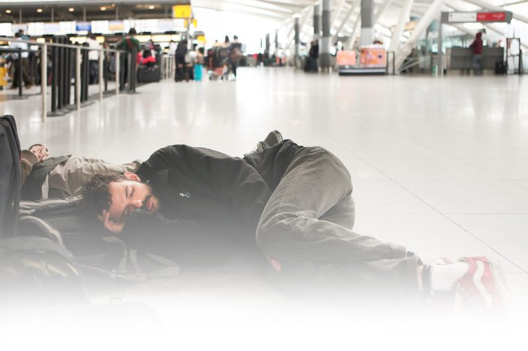 Bruno Rocha sleeps on the floor of John F. Kennedy Airport after having his flight to Brazil delayed due to a winter storm on January 27, 2011 in New York City.