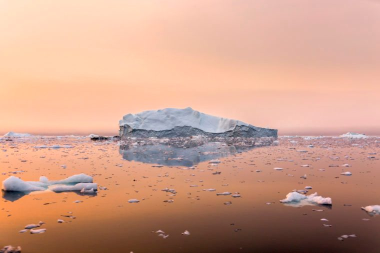 Iceberg in Greenland in the sunset climate change