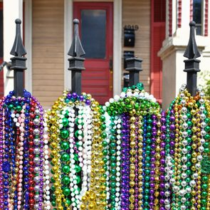 Mardi Gras beads decorate a wrought iron fence on Magazine Street on March 3, 2019 in New Orleans, Louisiana.