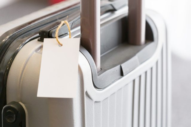Close up of blank luggage tag label on a suitcase