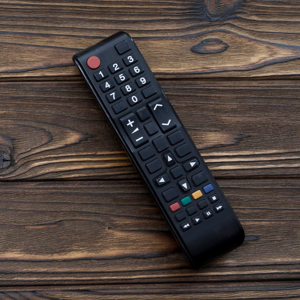 tv remote controll on wood coffee table background
