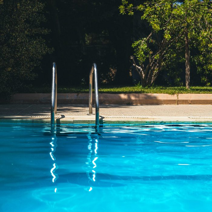 outdoor swimming pool. close up on ladder.