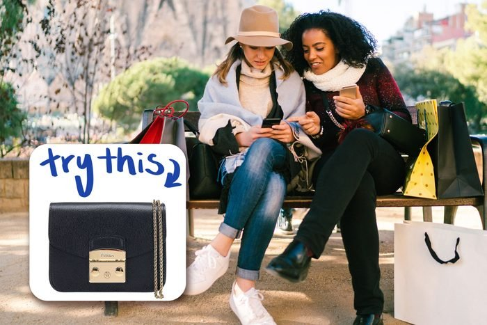 two women sitting on bench, with inset of purse to buy