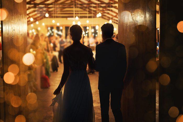 bride and grrom silhouette walking into wedding reception