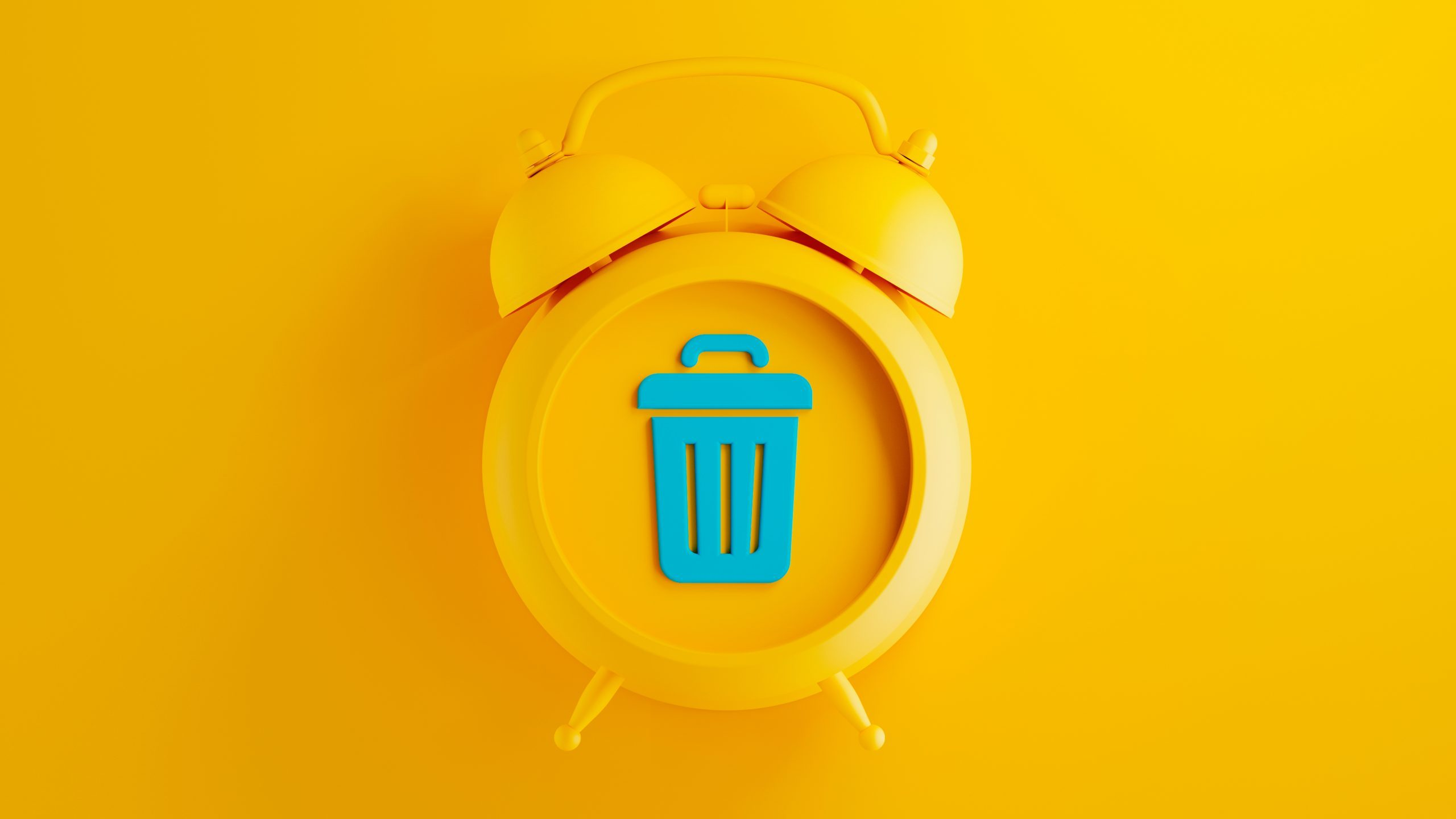 yellow alarm clock on yellow background with blue trash can symbol